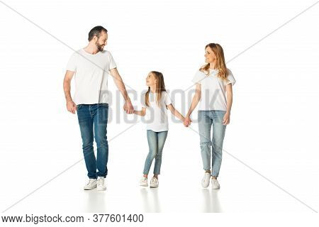 Happy Casual Family Holding Hands While Walking Isolated On White