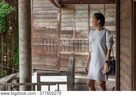 Short-hair Asian Lady Who Is Take Tour In Old Style Village. Wooden House Village. No Focus, Specifi