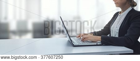 Young Businesswoman Working On Laptop In Modern Bright Coworking Office. Business Background Copy Sp