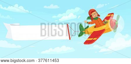 Kid On Airplane With Banner. Child Pilot Flying In Plane Among Clouds In Sky. Little Boy Having Flig