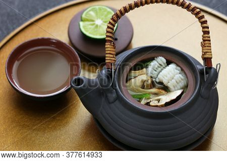dobin mushi (Japanese cuisine) : steamed matsutake mushroom and pike conger with Japanese broth in an earthenware teapot and served.