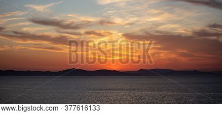 Sunrise, Sunset Clouds. Twilight, Dusk Cloudy Sky Over Sea Water, Dark Land Horizon