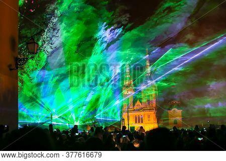 Zagreb, Croatia - 19 March, 2017 : Festival Of Lights In Zagreb, Croatia. People Watch A Laser Show