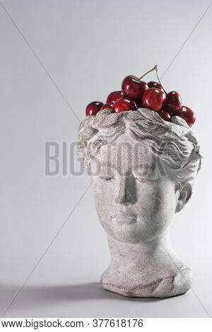 Stylish Decoration Made In Shape Of Greek Goddess Head Full Of Red Ripe Cherries. Beautiful Design E