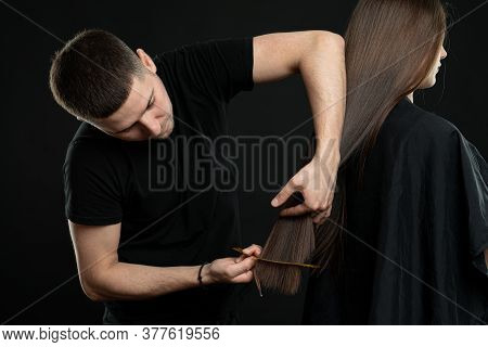 Side View Of Hairstylist Doing Hairstyle To Stylish Model