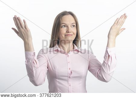 Smiling Glad Young Caucasian Woman Showing At Top With Both Hands Open Palms, Presenting. Woman Maki
