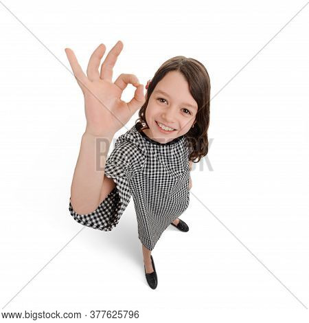 Child Showing Alright Sign With Her Hand