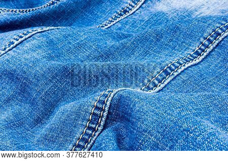 Clothing Items Blue Stonewashed Faded Jeans Cotton Fabric Texture With Seams, Clasps, Buttons And Ri