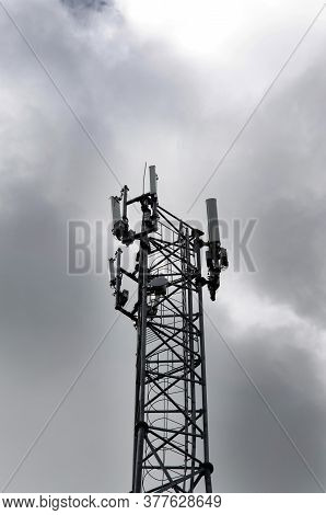 Telecommunications Tower With 4g, 5g Transmitters. Cellular Base Station With Transmitting Antennas