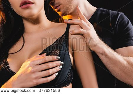 Cropped View Of Man Touching Sexy Woman In Bra Isolated On Black