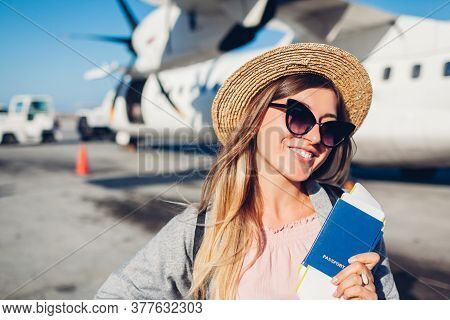 Woman Traveler Boarding On Plane Holding Passport Tickets. Happy Passenger With Backpack Ready For F