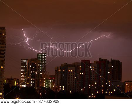 Lightning On The Background Of The Night City. Storm With Lightning In The City. Night Photography