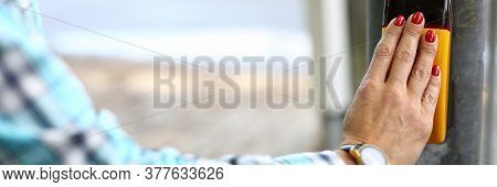 Close-up Of Woman Pressing Knob On Metal Pole. Inscription On Smart Screen Please Wait. Female With