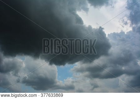 Dark Storm Clouds Before Rain. Blue Sky And Dark Cumulus Clouds. Cloudscape. Blue Sky And Fluffy Clo