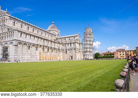 Pisa, Italy - August 14, 2019: View Of The Pisa Cathedral With The Leaning Tower Of Pisa In Piazza D