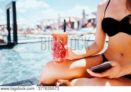 Young Hot Woman Resting At Swimpool. Cut View And Close Up Of Slim Well-built Girls Body In Swimsuit