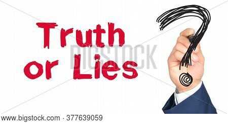 Hand With Marker Writing: Truth Or Lies. Hand Of A Businessman With A Marker.