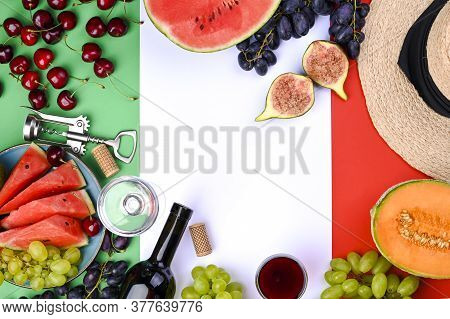A Bottle Of Wine, Wineglass, Grapes, Different Fruits And The Flag Of Italy. Country Symbol Backdrop