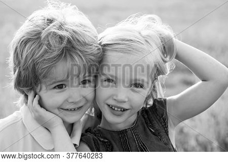 Beautiful Little Couple - Boy And Girl Embracing. Child Care. Beautiful Little Couple - Boy And Girl