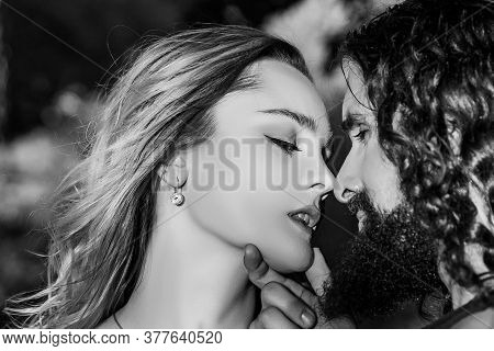 Couple In Love. Handsome Bearded Man Going To Kiss His Beautiful Sensual Woman. Romantic Date Of Cou