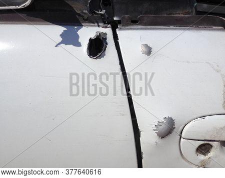 Automobile Shot Up Bullet Gun Fire Fight Holes