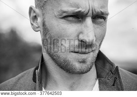 Young Handsome Hipster Ginger Bearded Guy Looking Brutal. Copy Space. Young Handsome Man In Jacket.