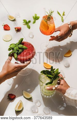Poplular Summer Alcohol Cocktails In Womans Hands Over White Background