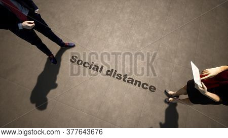 Concept or conceptual 3d illustration of a man woman meeting following social distance guidelines on a wooden floor background. A metaphor for the change in company relations during the lockdown