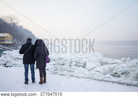 Belgrade, Serbia - January 21, 2017: People, A Couple Of Lovers, Walking Next To The Frozen Danube,