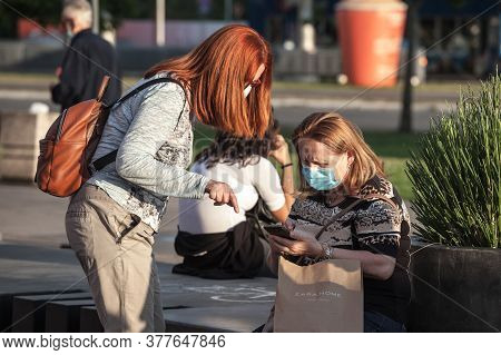 Belgrade, Serbia - July 19, 2020: Old Senior Women Wearing A Respiratory Facemask, Confused, Trying