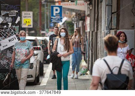Belgrade, Serbia - July 21, 2020: Women, Young Girls And Old Woman, Walking Wearing Face Mask Respir