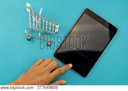 Hand Male Using And Touch Tablet With Online Shopping Cart On Blue Background,internet And Online Sh