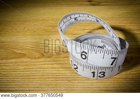 White Tailor Meter On A Wooden Table