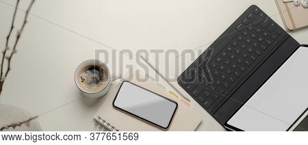 Portable Workspace With Mock Up Tablet, Smartphone, Notebooks, Coffee Cup, Decorations And Copy Spac