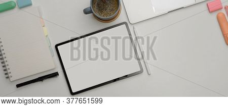 Study Table With Mock Up Tablet, Blank Notebook, Stationery, Supplies And Copy Space