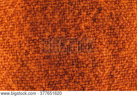 Macro Of A Rough Fabric Of Orange Colour.