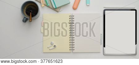 Study Table With Mock Up Tablet, Blank Notebook, Coffee Cup And Stationery