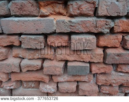 Ancient Masonry Of Red Brick Of Different Sizes