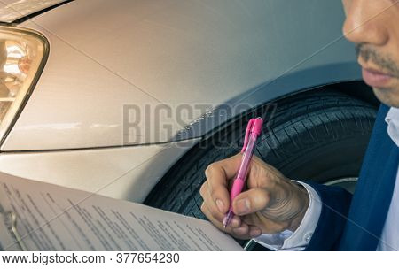 Asian Insurance Agent Or Insurance Agency In Suit Checking Car Crash Data Report From Accident For C