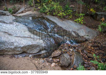 A Narrow Stream Of Water In Colorado Springs, Colorado