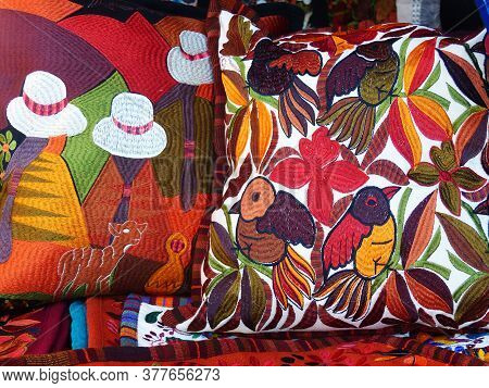 Cuenca, Ecuador - December 22, 2019: Close Up Of сolorful Embroidered Decorative Pillows And Textile