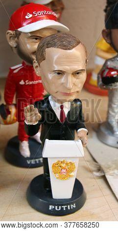 Lindos, Rhodes, Greece - July 12, 2020: Vladimir Putin Miniature Figurine At A Souvenir Shop In Lind