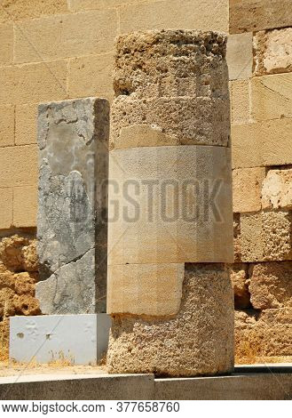 Lindos, The Acropolis. Remains Of Antique Doric Columns. Lindos Village, The Acropolis Hill, Greece
