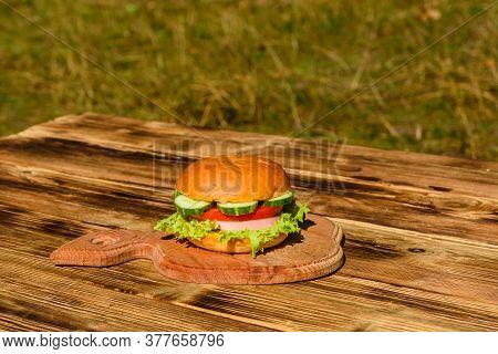 Fresh Hamburger On A Rustic Wooden Table