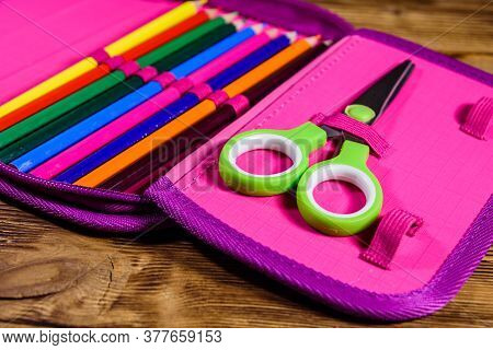 Different School Stationeries (pens, Pencils And Scissors) In Pink Pencil Box