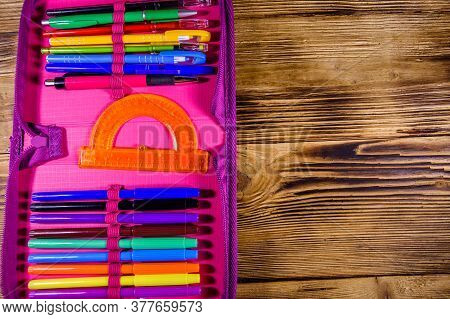 Different School Stationeries (pens, Pencils, Felt Tip Pens And Protractor) In Pink Pencil Box. Top