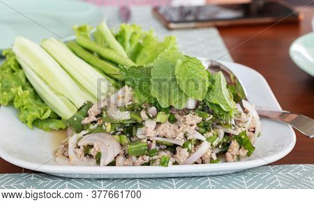 Close Up Spicy Minced Pork Salad With Vegetable On White Plate