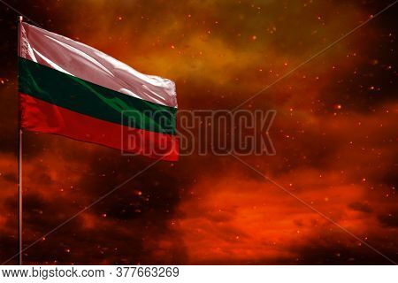 Fluttering Bulgaria Flag Mockup With Blank Space For Your Data On Crimson Red Sky With Smoke Pillars