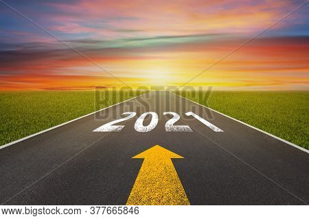 New Year 2021 Concept : Empty Asphalt Street Road And Writing Text 2021 On Roadway.
