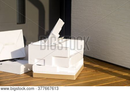 Styrofoam Package And Cardboard Boxes Abandoned Outside The House